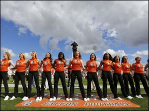 Bowling Green State University dance team members sing the alma mater before the Falcon football team plays Murray State.