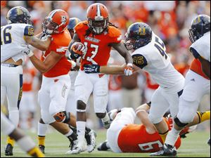 Bowling Green State University player Travis Greene (13) is tackled by Murray State player Perry Cooper (45) during the first quarter.