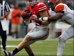 Ohio State TE Jeff Heuerman (86) makes a catch against Florida A&M during the first quarter.