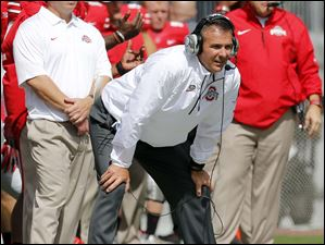 Ohio State head coach Urban Meyer watches the action against Florida A&M.