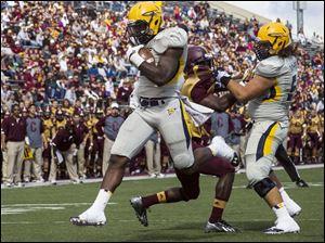 Toledo Rockets running back David Fluellen runs the ball for the first touchdown of the game Saturday afternoon against Central Michigan.