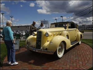Noreen Greathouse, of South Toledo, left, takes a look at a 1935 LeSalle.