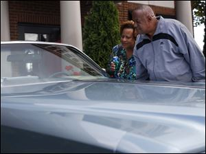 Frances and Charles Ester, of West Toledo, took a closer look at a 1975 Eldorado owned by Pam Berg of Akron.