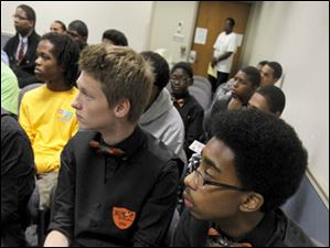 Waite student James Frankforther, left, and Bowsher's Randall Pryor listen to a speaker.