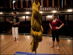 A daisy knot is tied during a beginner aerial silks class.