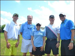 Committee member Nate Gaubert, left, with his teammates John Graham, Petra Cole, John McHale, and Rob Graham.