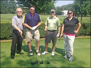 This foursome is Chamber Board of Trustees Chairman Jim Weber, Eric Heintschel, Nathan Syrek, and  Maggie Crowley.