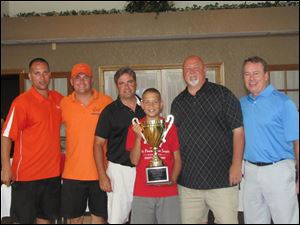 This is Sal and Rick with the winners of the Sal's Pals 10th Annual golf outing. From left is Rick Pinardo, Ron Reeder Jr., David Cervetto, Rich Jones and Mark Evans. Sal is holding the trophy.The team won with a 15-under par.