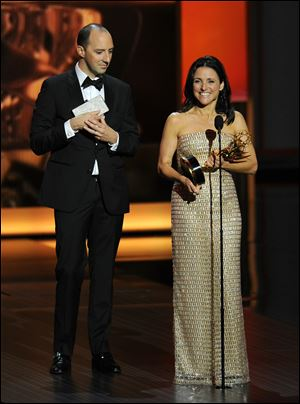 "Tony Hale watches as Julia Louis-Dreyfus accepts the award for outstanding lead actress in a comedy series for her role on ""Veep"" at the 65th Primetime Emmy Awards at Nokia Theatre on Sunday  in Los Angeles."