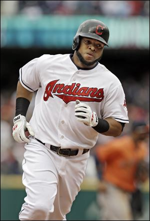 Cleveland Indians' Carlos Santana rounds the bases after a solo home run off Houston Astros relief pitcher Jorge De Leon in the eighth inning. The Indians won 9-2 to sweep the four-game series.