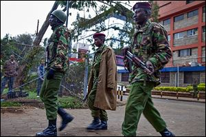 Kenyan security personnel take their positions outside the Westgate Mall. Gunfire and explosions were heard during the fighting at the upscale shopping center.