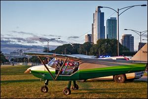 A plane is parked near Lake Shore Drive in Chicago on Sunday after the pilot, John Pedersen, made an emergency landing because of mechanical issues. He landed in the northbound lanes of Lake Shore Drive near Grant Park, authorities said.
