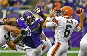 Browns quarterback Brian Hoyer (30 of 54 for 321 yards) passes the ball while getting pressured by Minnesota defensive tackle Sharrif Floyd.