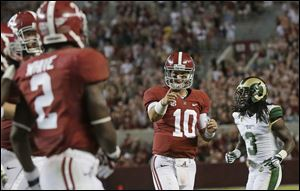 Alabama remained No. 1 and Nos. 2 through 14 remained unchanged in the latest AP Top 25 poll.