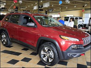 A 2014 Jeep Cherokee Trailhawk is on display at Charlie's Dodge in Maumee. Chrysler has temporarily slowed production of the new model for testing.