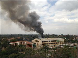 Heavy smoke rises from the Westgate Mall in Nairobi Kenya today after multiple large blasts rocked the mall where a hostage siege is in its third day.