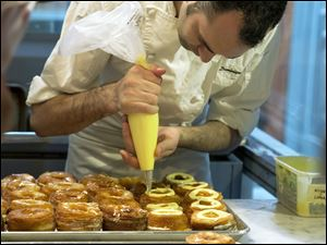 Chef Dominique Ansel makes Cronuts, a croissant-donut hybrid, at the Dominique Ansel Bakery in New York.