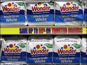 Wonder Bread — a familiar presence on store shelves for decades until last November — began returning to supermarkets on Monday after being bought by Flowers Foods from Hostess Brands.