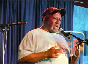 Poet  Melvin Douglas Johnson, 73, of Toledo performed in late 2011 at an event in the city. He says writing poetry helps him 'put things in perspective.'