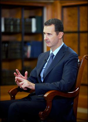 Syrian President Bashar Assad speaks during an interview with Chinese state CCTV, in Damascus, Syria, today. Assad said his government will allow international experts access to its chemical weapons sites but cautioned that rebels might block them from reaching some of the locations.