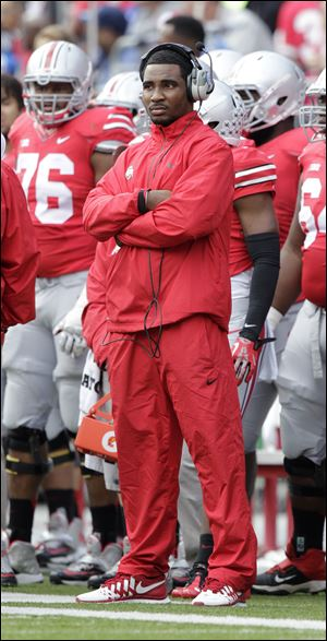 Ohio State quarterback Braxton Miller watches from the sidelines as Ohio plays against Florida A&M.