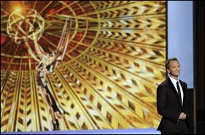 Host Neil Patrick Harris speaks on stage at the 65th Primetime Emmy Awards at Nokia Theatre  in Los Angeles.