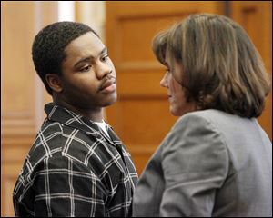 Traquawn Gibson, 19, confers with his attorney, Meira Zucker, as his jury trial begins for two deaths: the Oct. 18 murder of Deontae Allen of Toledo and the Nov. 18 aggravated murder of his longtime girlfriend, CreJonnia 'C.J.' Bell, also of Toledo.