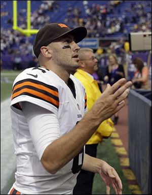 Browns quarterback Brian Hoyer tosses a wrist band to fans after Cleveland beat the Vikings on Sunday. It was his first win as a starter in the NFL.