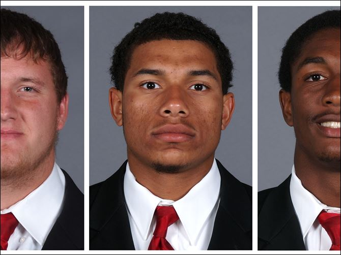 These photos taken in 2013 and provided by the University of Cincinnati on Sunday, Sept. 22, 2013, show Cincinnati football players, from left, Ben Flick, Javon Harrison and Mark Barr.