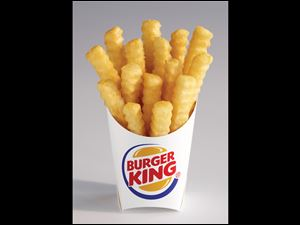 "Burger King shows the new french fry that the company says has 20 percent fewer calories than its regular fries. The ""Satisfries"" will cost about 30 cents more than its regular fries."