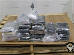 Troopers seized 42 pounds of cocaine and 2 pounds of black-tar heroin. The drugs, troopers said, are worth $2.07 million.