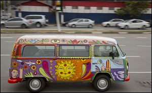 Advertising executive Marcelo Serpa drives his Volkswagen van, emblazoned with a 'rolling mural' that he painted, through the streets of Sao Paulo.