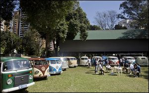 Members of the Sampa Kombi club, a group of Volkswagen van owners, gather for their monthly meeting in Sao Paulo. Brazil is the last place in the world still producing the vehicle.