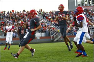 Bedford quarterback Brad Boss scores against St. Francis as Trent Santiago (86) celebrates. Boss has rushed for 349 yards on 35 carries.