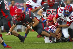 Bedford's Alec Hullibarger gains yardage against St. Francis. Hullibarger leads the team with 381 rushing yards in 48 carries.