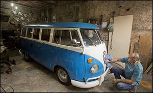 Enio Guarnieri wipes the emblem of his 1972 Volkswagen van in Sao Paulo. Guarnieri bought the van, or 'Kombi,' a year ago. When he was 10, his father taught him to drive a Kombi. 'Driving a Kombi with your face up against the windshield is a thrilling adventure,' he said. 'There is no other van like it.'