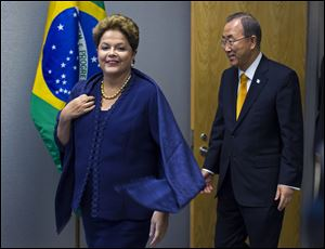 Dilma Rousseff, president of Brazil, arrives with United Nations Secretary-General Ban Ki-moon during the 68th session of the United Nations General Assembly at U.N. headquarters.