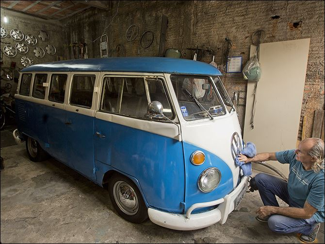 0001012900000000000 Enio Guarnieri wipes the emblem of his 1972 Volkswagen van in Sao Paulo. Guarnieri bought the van, or 'Kombi,' a year ago. When he was 10, his father taught him to drive a Kombi. 'Driving a Kombi with your face up against the windshield is a thrilling adventu