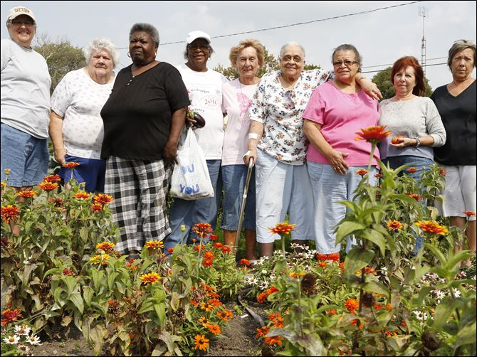 FEA wiar20p From left Cathy Jensen, Paula Unferdros, Geraldine Jacobs, Bessie Schuler-Oliver, Mary Frederick, Lorece Brown, Daisy Davis, Judy Day, and Linda Columbi in the Lakewood Villas garden.