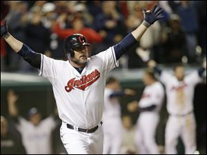 Cleveland Indians' Jason Giambi reacts after hitting a two-RBI home run off Chicago White Sox relief pitcher Addison Reed in the ninth inning.