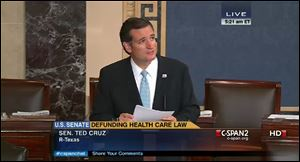 Senator Ted Cruz continues to speak on the floor of the U.S. Senate at 5:21 a.m. EDT  as seen on a C-SPAN broadcast.