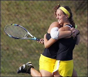 Perrysburg's Jordan Spidel, left, and Sarah Fastnacht won in No. 1 doubles against Northview's Kate Diment and Geeta Rao.