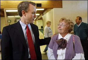 Ed FitzGerald, Cuyahoga County executive and Democratic gubernatorial candidate, talks with Sharon Belkofer, 71, of Perrysburg Township at the Chester Zablocki Senior Center in Toledo.