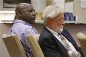 Michael Anthony Yates, left, sits with his attorney Jon Richardson during his bench trial before Judge Myron Duhart, Tuesday, September 24, 2013.