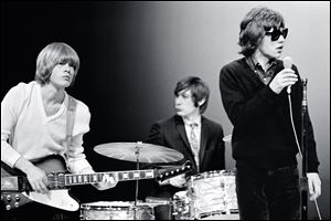 This Nov. 11, 1965 photo supplied by the Rock and Roll Hall of Fame and Museum shows, from left, Brian Jones, Charlie Watts and Mick Jagger of The Rolling Stones on the NBC teen music show