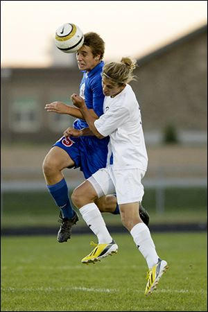 St. Francis de Sales senior Josh Albright, left, heads the ball in front of Northview's Cole Gonia. St. Francis is 7-1-2.
