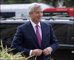 An $11 billion national settlement is under discussion to resolve claims over JPMorgan's handling of mortgage-backed securities in the run-up to the recession, said a government official familiar with ongoing negotiations among bank, federal and New York state officials.
