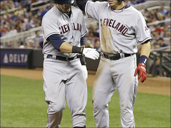 Indians Twins Baseball The Indians' Ryan Raburn, right, high-fives Mike Avilies after Raburn scored on an error by Minnesota's Chris Colabello at first base during the fourth inning of Thursday's game.