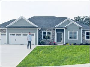 Builder Josh Doyle stands before the model home for Whitehouse Valley.