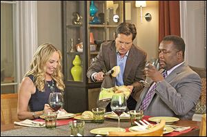 From left, Tracy Pollan, Michael J. Fox, and Wendell Pierce in a scene from 'The Michael J. Fox Show.'